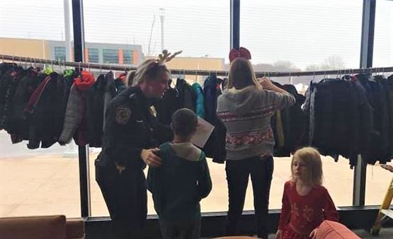Fridley Police officer helps children pick out coats