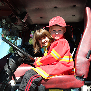 kids in fire truck at Fire Open House